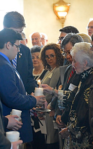 Bryce Connolly and Kyle Erickson help survivor - Betty Grebenschikoff light her candle in honor of 1 of the 6 million Jewish men, women and children who perished during the Nazi Era