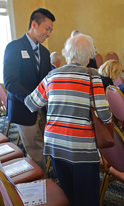 Tommy Pham helps seat Elsa Dreels,  one of the 14 Holocaust survivors present at the service