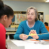 Volunteer Carolyn Waite teaches Johnny Appleseed Elementary School fourth grader Adelina Olivo, 10, how to knit on Tuesday at the school. The Johnny Appleseed Elementary School in Leominster has a new program they call Bridges Together. It brings older volunteers in to meet and teach the students some of things they have learned over the years and for the students to show them new stuff. SENTINEL & ENTERPRISE/JOHN LOVE