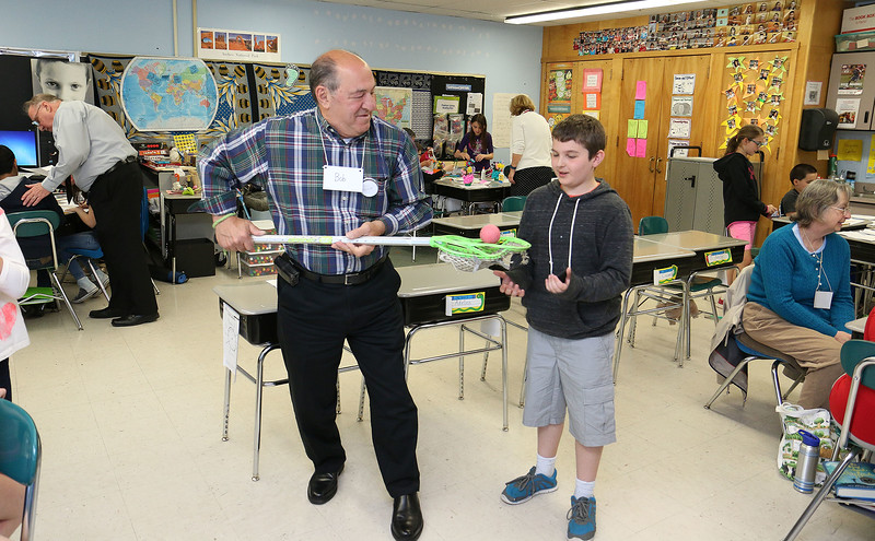 Volunteer Bob Marchetti learns a little about Lacrosse from Johnny Appleseed Elementary School fourth grader Quinn Maher-Killelea on Tuesday at the school. The Johnny Appleseed Elementary School in Leominster has a new program they call Bridges Together. It brings older volunteers in to meet and teach the students some of things they have learned over the years and for the students to show them new stuff. SENTINEL & ENTERPRISE/JOHN LOVE