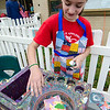 Callie Nelson, a student volunteer from Sky View Middle School, works on some spin art during the Johnny Appleseed Lawn Party in Leominster on Saturday afternoon. Funds raised during the event go towards student activities throughout the year. SENTINEL & ENTERPRISE / Ashley Green