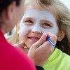 Paige Prentiss, 6, gets her face painted during the Johnny Appleseed Lawn Party in Leominster on Saturday afternoon. Funds raised during the event go towards student activities throughout the year. SENTINEL & ENTERPRISE / Ashley Green