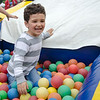 Jaxon Darcangelo, 3, plays in the ball pit during the Johnny Appleseed Lawn Party in Leominster on Saturday afternoon. Funds raised during the event go towards student activities throughout the year. SENTINEL & ENTERPRISE / Ashley Green