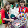 Gina Russo and Callie Nelson, student volunteers from Sky View Middle School, work on some spin art during the Johnny Appleseed Lawn Party in Leominster on Saturday afternoon. Funds raised during the event go towards student activities throughout the year. SENTINEL & ENTERPRISE / Ashley Green