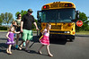 Walton Farm Elementary School hosted K-Day, an opportunity for kindergartners to become familiar with  how to safely board and  ride on a school bus.    Thursday,  August 7, 2014.   Photo by Geoff Patton