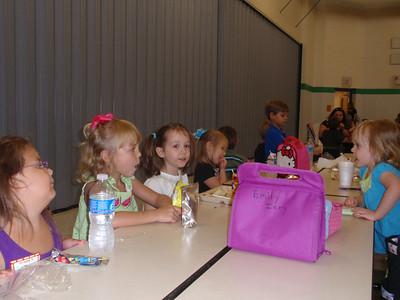 Lauren is enjoying eating lunch with Katie's Kindergarten class.
