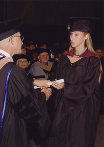 Kelly walking across the stage.