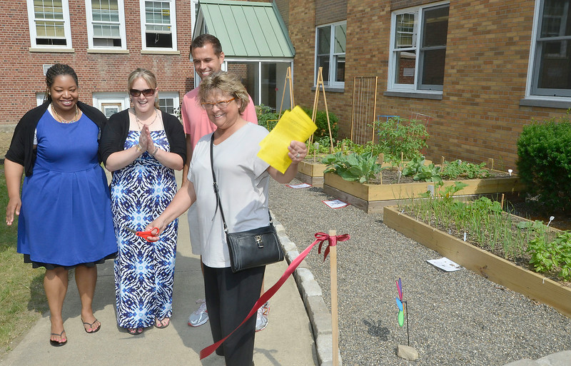 Mike McMahon - The Record , Knickerbacker Middle School students (6th, 7th, and 8th graders) had a ribbon cutting for the expanded gardening project in the school's courtyard. Wednesday June 25, 2014