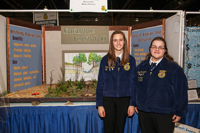 Patriot photos by Roxanne Richardson Kristy Heffner, current Kutztown FFA president, and Kayla Fusselman, former Kutztown FFA president with their Agriculture Education Exhibit with a board demonstrating the Riparian Zone on a farm. The entry earned a fourth place award.