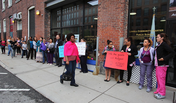 Board of Trustees meeting of the Lowell Community Charter Public School. Parents and staff show up in force, mostly in support of head of school Kathy Egmont. Parents assemble outside before the meeting. (SUN/Julia Malakie)