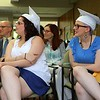 Leominster Center for Excellence graduates Mercedes Cotto and Kelsey Rodriguez watch a slideshow about their time at the school during the schools first graduation on Thursday afternoon. SENTINEL & ENTERPRISE/JOHN LOVE