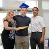 Leominster Center for Excellence graduate Ricky Martinez got his diploma given to him by her parents Christina and Rick Martinez during the schools first graduation on Thursday afternoon. SENTINEL & ENTERPRISE/JOHN LOVE