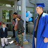 Leominster Center for Excellence graduate Alex Ferguson, on right, waits for the schools first graduation to start on Thursday afternoon. SENTINEL & ENTERPRISE/JOHN LOVE