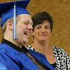 Leominster Center for Excellence graduate Alex Ferguson has a good laugh as he listens to senior advisor Pam Gordon talk about him during her speech to the graduates at the schools first graduation on Thursday afternoon. Just behind him is Principal Carrie Duff. SENTINEL & ENTERPRISE/JOHN LOVE