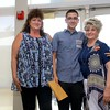Leominster Center for Excellence graduate Vinny D'Innocenzo got his diploma given to him by her Mom Dawn Marie Homon and his grandmother Patricia Homon during the schools first graduation on Thursday afternoon. SENTINEL & ENTERPRISE/JOHN LOVE