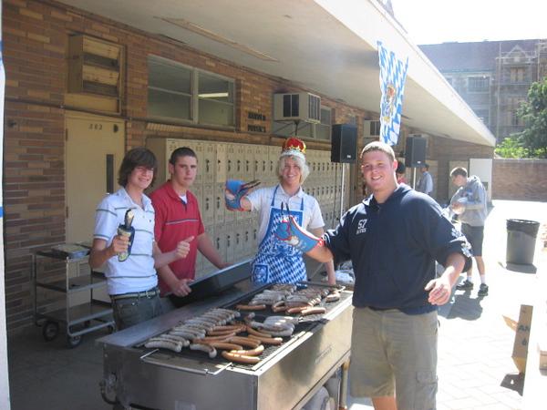 Grillmeisters Martin Reising, Wade LaRouche, John Toy (VP German Club), and Nigel Davies (Pres, German Club).