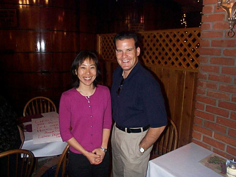 Rick Pedroarias turns over the chairmanship of language department to Teri Yamauchi in summer 2002 at San Antonio Winery.