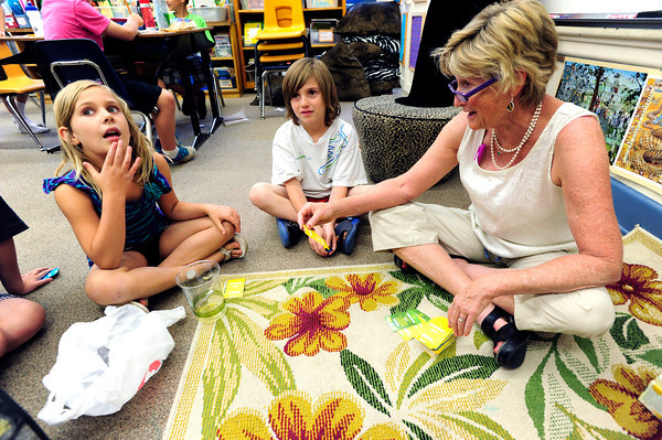 """Madeline Forney struggles for an answer to teacher Brieda Gessaman's word clue during the 2nd graders work on rhyming words in the literacy portion of the day's curriculum in at Whittier Elementary on Tuesday  May 22, 2012. Ethan Reich waits for his turn in the game. <br /> For more photos go to  <a href=""""http://www.dailycamera.com"""">http://www.dailycamera.com</a><br /> Photo by Paul Aiken"""