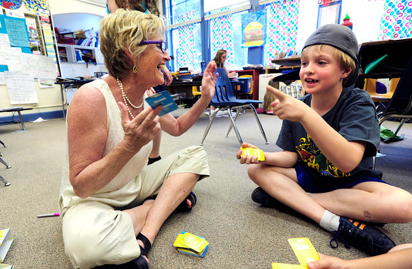 "Baker Hahn figures out the right rhyming word to teachers Brieda Geesaman's clue during the 2nd graders work on rhyming words in the literacy portion of the day's curriculum in at Whittier Elementary on Tuesday  May 22, 2012. For more photos go to  <a href=""http://www.dailycamera.com"">http://www.dailycamera.com</a><br /> Photo by Paul Aiken <br /> Brieda Gessaman"