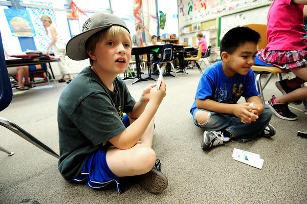"Baker Hahn, struggles with the clue during a game of rhyming GO FISH as David Plascencia Galvan waits his turn during the 2nd graders work on rhyming words in the literacy portion of the day's curriculum in Brieda Gessaman's class at Whittier Elementary on Tuesday  May 22, 2012. For more photos go to  <a href=""http://www.dailycamera.com"">http://www.dailycamera.com</a><br /> Photo by Paul Aiken <br /> Brieda Gessaman"