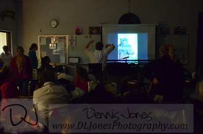 I enjoyed seeing the kids watching a slide show of the images I had taken the previous night.