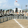 Don Knight | The Herald Bulletin<br /> Lapel band members play garbage cans during their State Fair Band Day routine on Saturday.