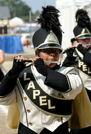 Don Knight | The Herald Bulletin<br /> Abby Specht plays the piccolo during the State Fair Band Day competition on Saturday.
