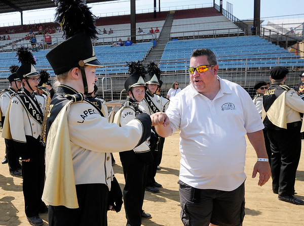 Don Knight | The Herald Bulletin<br /> Lapel band director Chris Glove encourages his students before their performance at Indiana State Fair Band Day on Saturday.