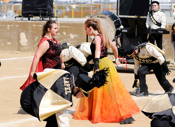 Don Knight | The Herald Bulletin<br /> From right, Pele, portrayed by Audrey Webb, battles her evil sister portrayed by Maria Stacey at Indiana State Fair Band Day on Saturday.