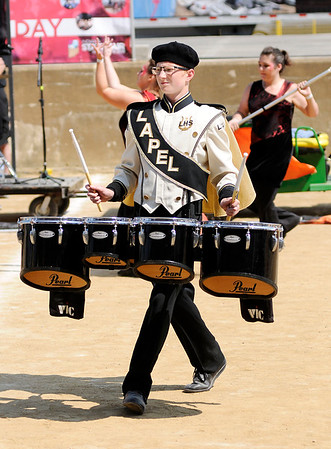 Don Knight | The Herald Bulletin<br /> Noah Swart performs with the Marching Bulldogs during Indiana State Fair Band Day on Saturday.