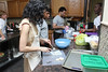 """Mrs. Tuorto and her students in the """"Real Men Cook Dinner"""" spring phase project prepare pastry in the new Leahy House kitchen."""