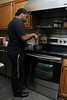 Jalen Jones prepares a lemon custard on the new range in the Leahy House kitchen.