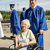Edie Martini greets grandson Ryan Potvin while waiting for the start of the Leominster High School graduation at Doyle Field on Saturday morning. SENTINEL & ENTERPRISE / Ashley Green