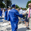 Graduates enter the Leominster High School graduation ceremony at Doyle Field on Saturday morning. SENTINEL & ENTERPRISE / Ashley Green