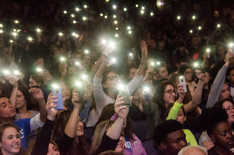 Students shine their cell phones during the annual Leominster High Life Skills talent show on Friday afternoon. SENTINEL & ENTERPRISE / Ashley Green