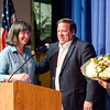 Retiring Headmaster Patricia Tuzzolo is presented with flowers during the Leominster High School undergraduate awards ceremony on Tuesday evening. SENTINEL & ENTERPRISE / Ashley Green