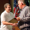 Lance Savage is presented the World Geography award during the Leominster High School undergraduate awards ceremony on Tuesday evening. SENTINEL & ENTERPRISE / Ashley Green