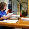 Leominster High School senior Rebecca Corbett, 18,  sorts through papers during her job at Leominster Employee Federal Credit Union for the school department's school to career program. SENTINEL & ENTERPRISE/JOHN LOVE