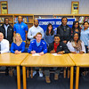 Leominster High School seniors (seated at center), Neil O'Connor (left) and Jarell Addo (right), along with family, pose for a letter of intent signing ceremony, Thursday morning. O'Connor will be going to the University of New Hampshire and Addo will be going to UMass Amherst.<br /> SENTINEL & ENTERPRISE / BRETT CRAWFORD