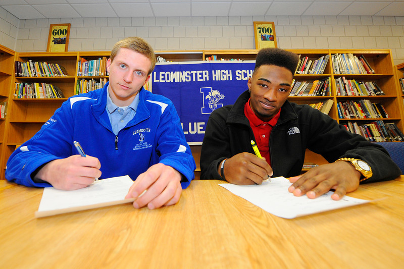 Leominster High School seniors, from left, Neil O'Connor and Jarell Addo pose for a letter of intent signing ceremony, Thursday morning. O'Connor will be going to the University of New Hampshire and Addo will be going to UMass Amherst.<br /> SENTINEL & ENTERPRISE / BRETT CRAWFORD