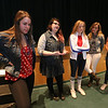 Littleton High School students walk out of classes and assemble in the auditorium in solidarity with the students and victims of the shootings in Parkland, Florida. From left, senior Abbi Hartzel, 18, junior Sarah Gordon, 17, and seniors Rachel Coupal, Alyssa Albertelli and Haley Corbett, all 18, speak to reporters after the program. (SUN/Julia Malakie)
