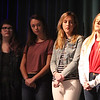 Littleton High School students walk out of classes and assemble in the auditorium in solidarity with the students and victims of the shootings in Parkland, Florida. From left, junior Sarah Gordon, 17, and seniors Haley Corbett, 18, Alyssa Albertelli, 18, and Rachel Coupal, 18, who all spoke, listen to fifth speaker. (SUN/Julia Malakie)