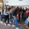 Littleton High School students walk out of classes and assemble in the auditorium in solidarity with the students and victims of the shootings in Parkland, Florida. (SUN/Julia Malakie)