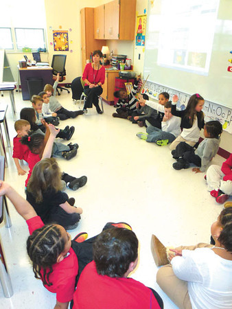 Debbie Wachter/NEWS<br />  Teacher Reane Cotelesse teaches her students reading by making them say in whole sentence how they will protect their new school.