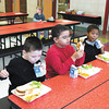 Debbie Wachter/NEWS<br /> Nikolai Chadwell, left, Demetrius Fambro, center and Mason Cook, kindergarten students,  enjoy lunch the first day in their new school.