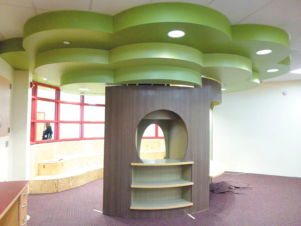 Debbie Wachter/NEWS<br /> A tree of learning stands in the middle of a reading room at Lockley.