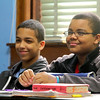 Longsjo Middle School seventh graders Devin Deleon and Melvin Mahones listen to her social studies teacher Matt Lamey as he instructs his students in class on Friday morning just before they headed down to the library to use the computers. SENTINEL & ENTERPRISE/JOHN LOVE