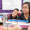 Longsjo Middle School seventh grader Megan Duong listens to her social studies teacher Matt Lamey as he instructs his students in class on Friday morning just before they headed down to the library to use the computers. SENTINEL & ENTERPRISE/JOHN LOVE
