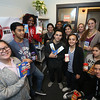 Some of the Lowell High students who are setting up a food pantry for LHS students, from left: junior Ngan Pham, seniors Phatphomviracboth Soeur, Rebecca Bitegetsimana, Abdiel Gonzalez (scarf), Yancarlos Cordero (front), Marifer Adames Rojas (rear), Sara Vivas Rojas, Carla Duran LHS '16 of Lowell (stripes), B-house clerk Laurie McAnespie of Lowell (rear), US History and ELL teacher Jessica Lander of Cambridge, and seniors Wilmary Lopez and Peter Gonzalez. (SUN/Julia Malakie)