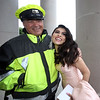 Allyson Imbacuan, arriving at Lowell High prom, hugs school resource officer John Boutselis, who she's known since 9th grade. Boutselis said this is his last Lowell High prom, because he's retiring. (SUN/Julia Malakie)